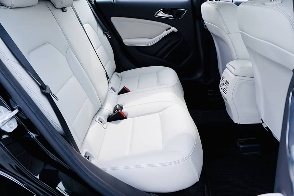What causes yellow stains on leather car seats